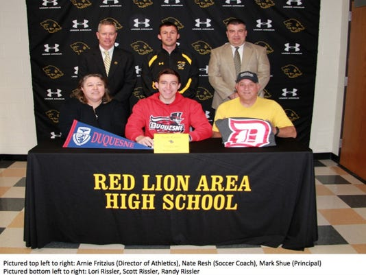 This past school year, Red Lion student-athlete Scott Rissler committed to play college soccer at Duquesne University. Here, Rissler is joined by his mother Lori (bottom left) and father Randy (bottom right). Also pictured, top row, left to right: Red Lion athletic director Arnie Fritzius, head soccer coach Nate Resh and principal Mark Shue.