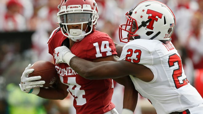 Texas Tech cornerback DaMarcus Fields (23) closes in to tackle Oklahoma wide receiver Charleston Rambo during the Red Raiders' 55-16 loss last year. No. 24 Oklahoma will visit Jones AT&T Stadium Saturday, taking on a Tech team coming off a win against West Virginia.
