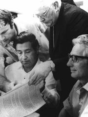 United Farm Workers organizing committee chairman Cesar Chavez, seated left, and grower representative John Guimarra Jr., seated right, prepare to sign a contract ending the long Delano grape strike on July 29, 1970.
