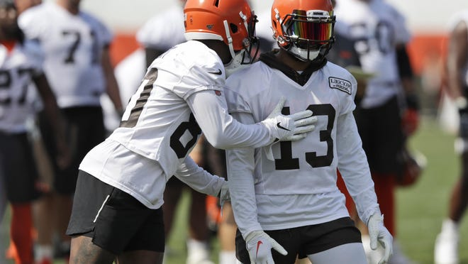 Browns wide receiver Jarvis Landry, left, talks with wide receiver Odell Beckham Jr. during training camp last summer. The NFL hopes to open training camps next week.
