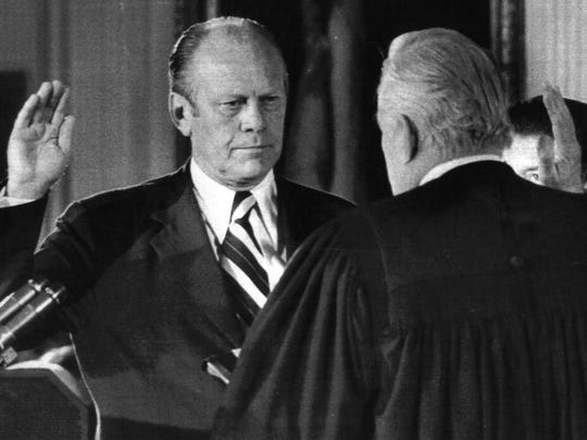On Aug. 9, 1974 President Nixon's resignation became effective at noon and Vice President Gerald Ford was sworn in as the nation's 38th chief executive. Administering the oath is Chief Justice Warren Burger.
