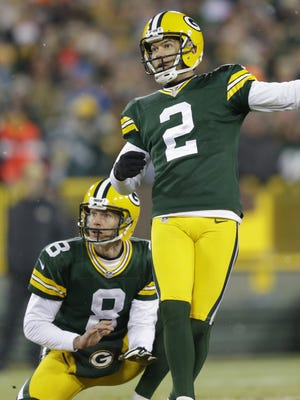Green Bay Packers kicker Mason Crosby watches with holder Tim Masthay as his field-goal attempt is blocked by the Detroit Lions during the fourth quarter of their game at Lambeau Field on Dec. 28.