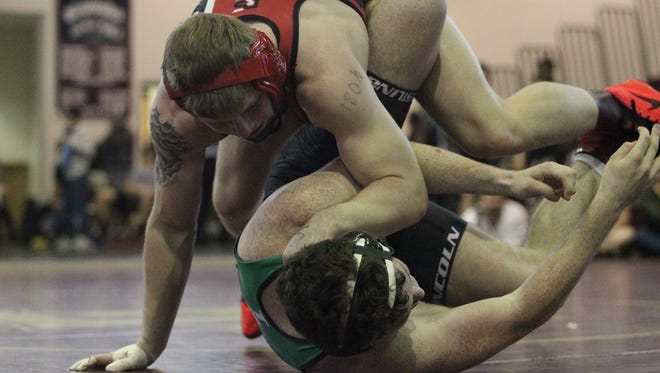 Leon senior J.T. Grant works toward pinning Lincoln's Gus Altenburg during Saturday's action at Florida High. Grant was the 182-pound winner in the tournament.