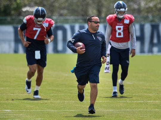 Titans assistant equipment manager Joey Barranco races up the field with quarterbacks Blaine Gabbert (7) and Marcus Mariota (8) during practice at Saint Thomas Sports Park  Tuesday, Aug. 28, 2018, in Nashville, Tenn.