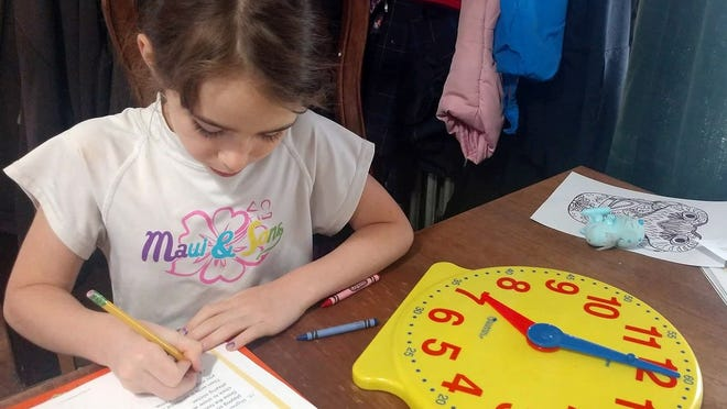 Meira Roberts, 6, works on mathematics during a remote lesson over the spring quarantine.  Meira's siblings have experienced homeschooling, remote learning, public and private schools, depending on what is best for that particular child.