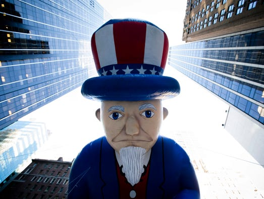 A giant Uncle Sam balloon is marched down 6th Avenue.