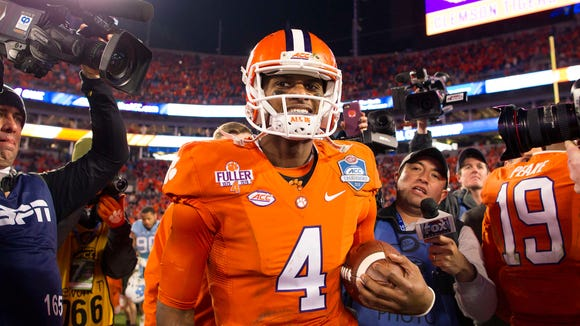 Dec 5, 2015; Charlotte, NC, USA; Clemson Tigers quarterback Deshaun Watson (4) walks off the field after defeating the North Carolina Tar Heels 45-37 in the ACC football championship game at Bank of America Stadium. Mandatory Credit: Joshua S. Kelly-USA TODAY Sports
