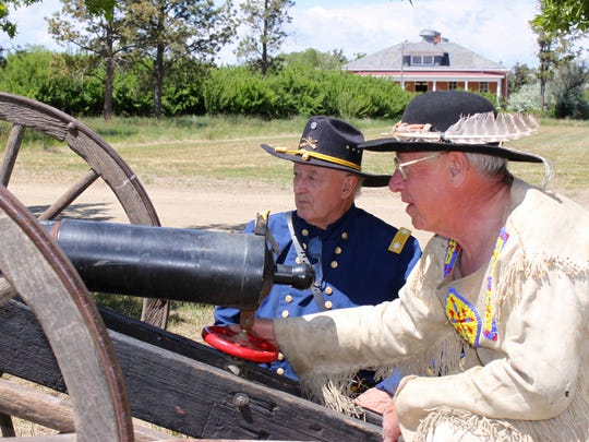 Jim Griggs, right, and Dick Hanson prepare to test the fire power at Fort Assiniboine during Havre's Living History Weekend.