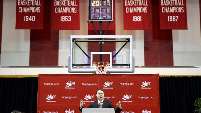 New Indiana coach Archie Miller answers a question during a news conference on the court in Assembly Hall after he was introduced in Bloomington, Ind., Monday, March 27, 2017.