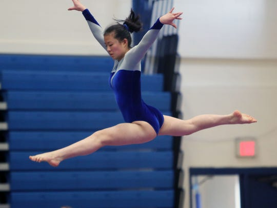 Mahopac's Chloe Lee competes on the balance beam during