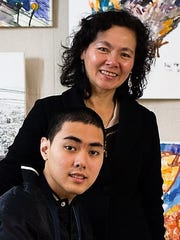 Ping Lian Yeak, an artist, poses with his mother, Sarah