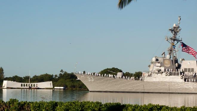 USS Arizona 73rd anniversary 12/7/14 Survivor Toast- Guided missile ship Chung-Hoon passes by the USS Arizona Memorial on the 73rd anniversary of the attack Pearl Harbor that sank the battleship killing 1,177 sailors.