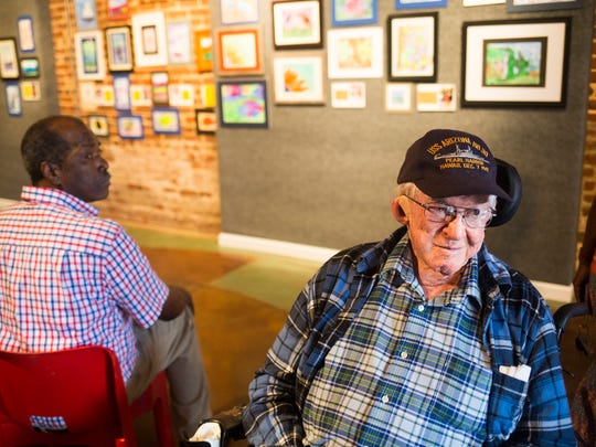 Sam Hank smiles as people filter in to see watercolors created by him and his peers at an art exhibit of original watercolors created by local senior citizens through a program called Senior Studio on Tuesday, September 27, 2016 at the Anderson Arts Center.