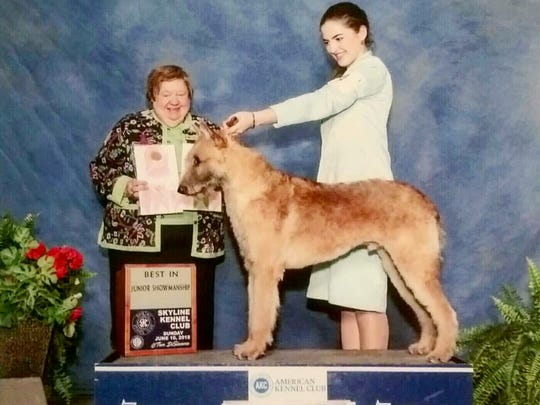 Carol Noe, left, recently judged at a dog show in Qingdao,