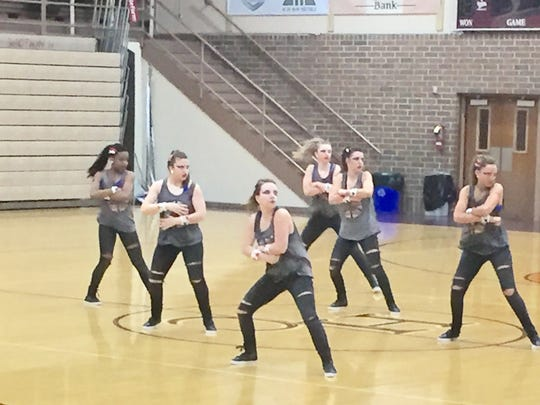 Henderson County High's Colonelettes perform for family