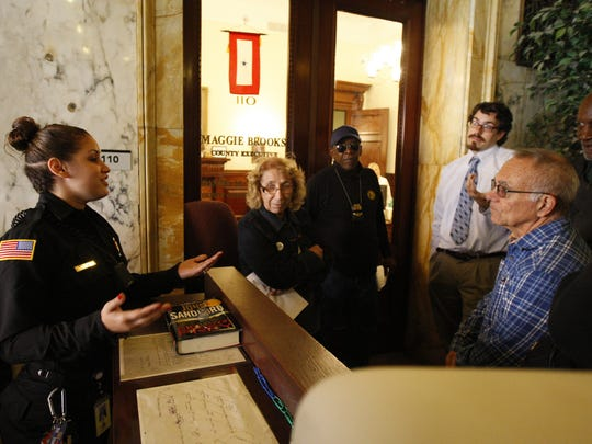 Sister Grace Miller and others wait outside Monroe County Maggie Brooks' office on Friday afternoon.