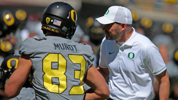 Sep 3, 2016; Eugene, OR, USA;  Oregon Ducks head coach Mark Helfrich talks with tight end Johnny Mundt (83) before the game against the UC Davis Aggies at Autzen Stadium. Mandatory Credit: Scott Olmos-USA TODAY Sports