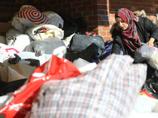 Amanny Ahmed, 20, of Paterson sorts through a mound of donations to be sent to Yemen for refugees. People at the Islamic Center of Passaic County in Paterson were overwhelmed by the generosity of donors. By early afternoon on Sunday, Jan. 14, 2018, they had to turn away donors because the volume that they had accepted was already too much for their shipping container.