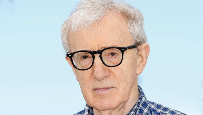 Woody Allen poses during the photocall for 'Irrational Man' at the 68th annual Cannes Film Festival, in Cannes, France.