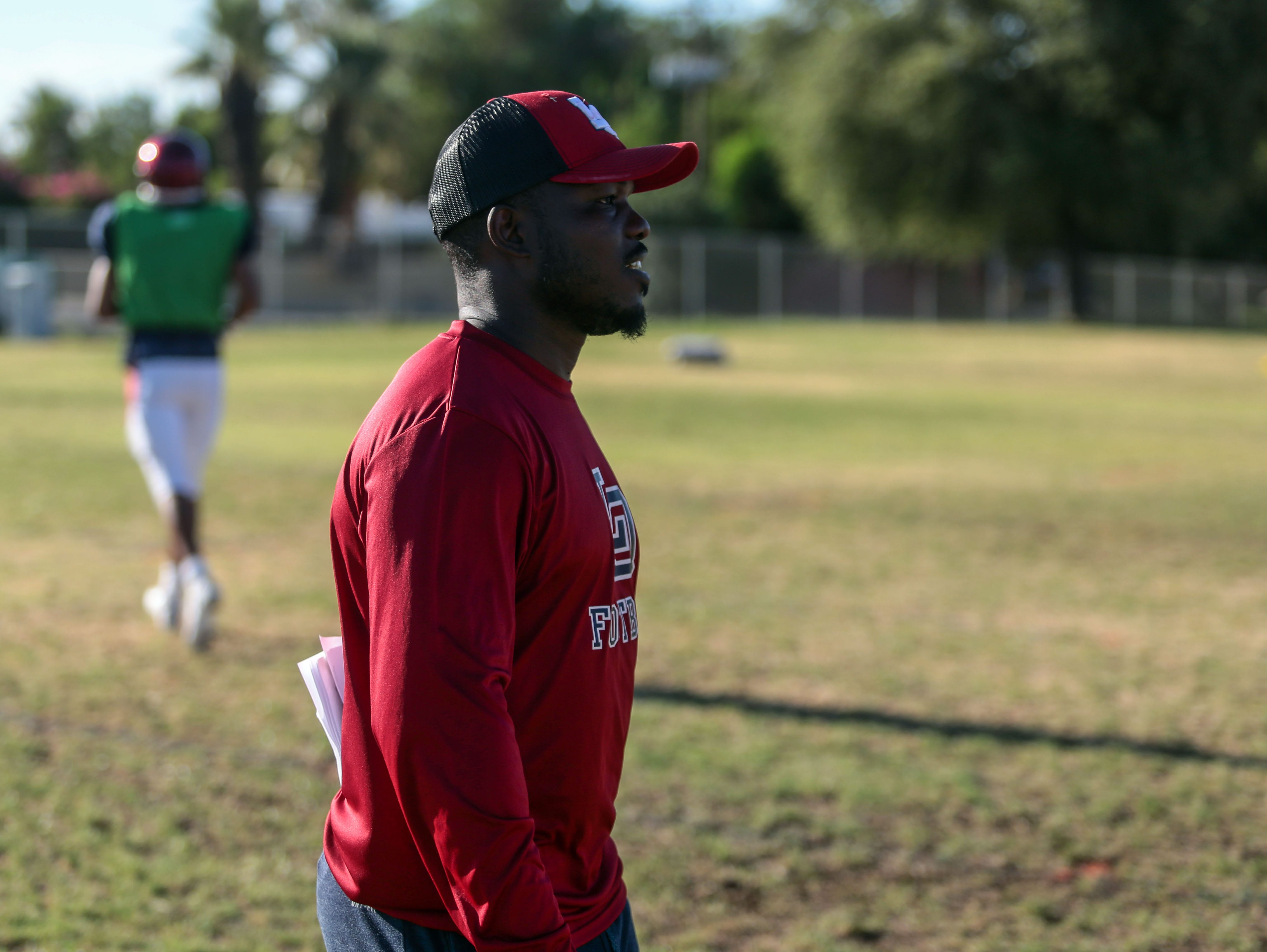 Champion boxer Timothy Bradley assist in the defensive coaching during La Quinta football team practice on Tuesday, August 16, 2016 in La Quinta.