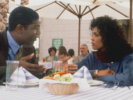"Dennis Haysbert and Whitney Houston star in ""Waiting to Exhale."""