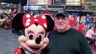 Taking a picture with Minnie Mouse was all part of the tourist experience for columnist Joe Phalon.