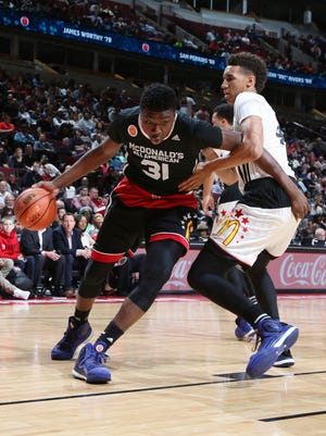 Thomas Bryant (31) drives to the basket against West team forward Chase Jeter (4) during the McDonald's High School All American Game at the United Center in Chicago.