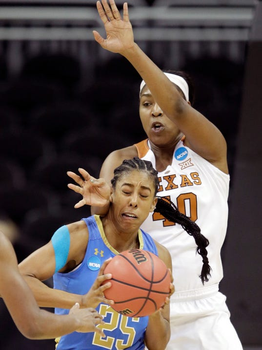 UCLA forward Monique Billings (25) is covered by Texas forward Jatarie White (40) during the first half of a women's NCAA college basketball tournament regional semifinal game, Friday, March 23, 2018, in Kansas City, Mo. (AP Photo/Orlin Wagner)