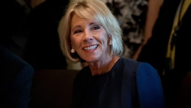 Education Secretary Betsy DeVos attends a Cabinet meeting with President Donald Trump, Monday, June 12, 2017, in the Cabinet Room of the White House in Washington.
