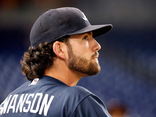 FILE - In this Sept. 28, 2017, file photo, Atlanta Braves' Dansby Swanson looks out from the dugout before the start of a baseball game against the Miami Marlins in Miami. Teammates Dansby Swanson and Sean Newcomb are hoping to rebound from rocky seasons. (AP Photo/Wilfredo Lee, File)