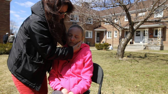 Neighbor Karen Travis on Wednesday hugs   April Burgio, the mother of Brittany Burgio, 17, who died after being struck by a car on Dewey Avenue in Rochester on Tuesday.