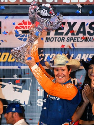 Scott Dixon, of New Zealand, celebrates after winning the IndyCar auto race Saturday, June 9, 2018, in Fort Worth, Texas.