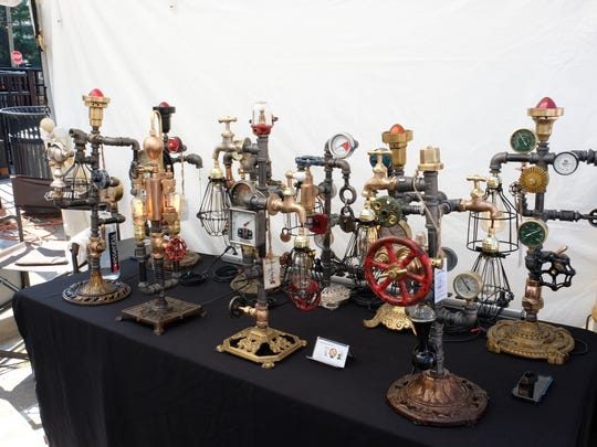 Industrial lamps created from almost entirely repurposed materials by musician Joe Mazzola of Detroit showcased at the Ferndale DIY Festival on Sept. 23.