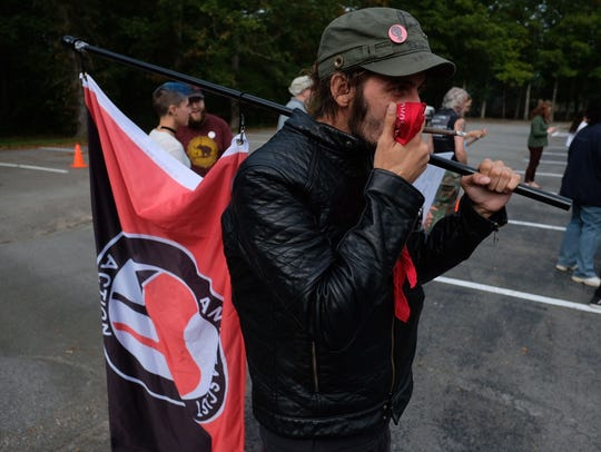 A protester representing Antifa joined a group protesting