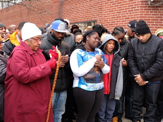 Family members of Darren Weathers at his vigil on Feb.