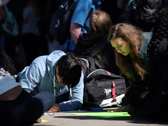 Students make signs at L&N STEM Academy and participate in a national walkout on Friday, April 20, 2018. The walkout was planned on the 19th anniversary of the Columbine tragedy.