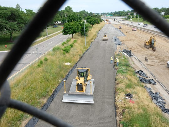 Michigan Department of Transportation officials held a press conference Tuesday, June 19, 2018, in Roseville and announced that freshly laid pavement on I-696 near Gratiot had to be removed due to a common equipment issue. (Sarah Rahal / The Detroit News)