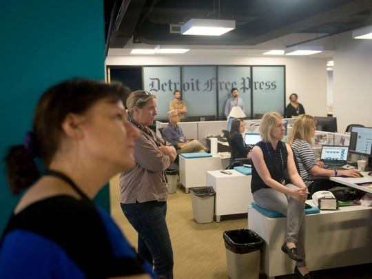 From left, Freep Now Director Maryann Struman, photographer Mandi Wright and reporter Elisha Anderson observe a moment of silence July 5, 2018 in the Detroit Free Press newsroom to honor the victims of the Capital Gazette shooting that occurred June 28, 2018 in Annapolis, Md.