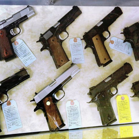 In this July 10, 2013 file photo, semi-automatic...