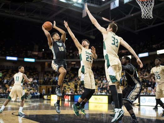 Adonys Henriquez attempts a floater against USF.