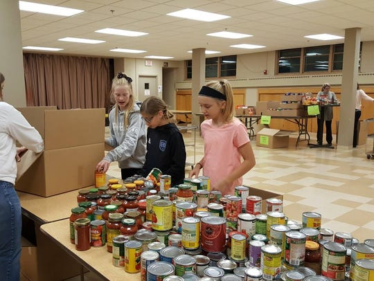 Tosa Cares volunteers start sorting food donated from