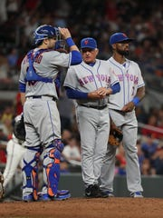 Mets manager Terry Collins (10) talks with catcher Travis d'Arnaud (18) and third baseman Jose Reyes (7) after relieving relief pitcher Fernando Salas (not pictured) in the ninth inning against the Atlanta Braves at SunTrust Park on Friday, June 9, 2017.