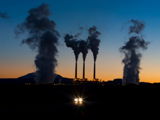 Evaporated water leaves the top of the stacks of the Navajo Generating Station in Page.