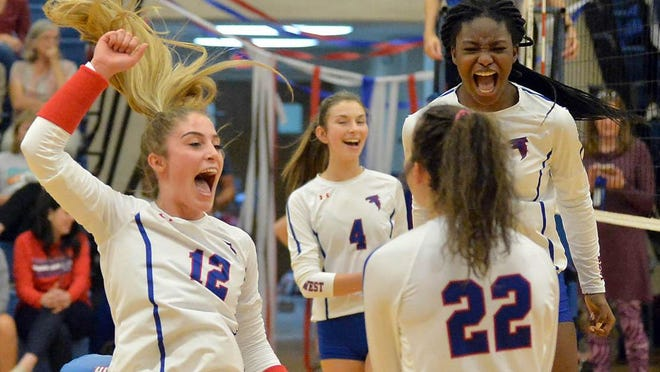 West Henderson players cheer following a point against A.C. Reynolds last year at West.