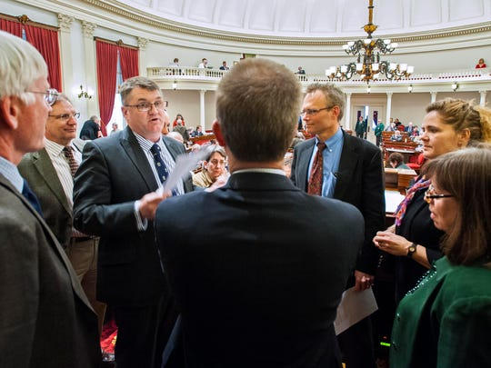 House Republican leader Rep. Don Turner, R-Milton, third from left, discusses a point of parliamentary procedure with House Speaker Shap Smith, D-Morristown, center, and other legislators as the House debates a bill that would ban teachers strikes at the Statehouse in Montpelier on Wednesday.