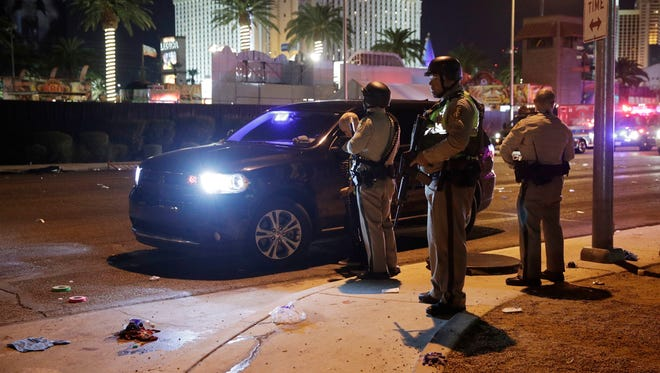 Las Vegas Police stand at the scene of a shooting along the Las Vegas Strip, Monday, Oct. 2, 2017, in Las Vegas. Multiple victims were being transported to hospitals after a shooting late Sunday at a music festival on the Las Vegas Strip.