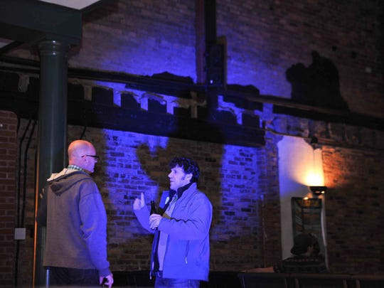 Russell Huxtable and Derek Cole chat before the beginning of the first Revival House at the Milton Theatre in March.