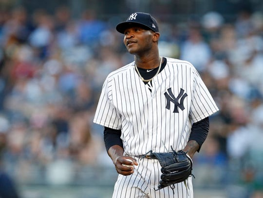 New York Yankees pitcher Domingo German (65) reacts