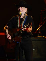 Willie Nelson performs on stage at the 2015 MusiCares