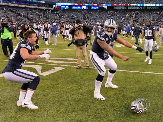 Dallas Cowboys quarterback Dak Prescott (4) celebrates after beating the New York Giants 30-10 in an NFL football game, Sunday, Dec. 10, 2017, in East Rutherford, N.J.